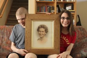 The kids posing with their grandma.