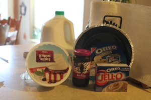 Hot fudge dessert topping, 1 Oreo pie crust, 1 8oz, tub of Cool Whip, cold milk, and 2 pkg. (4 serving size each) Jello Oreo flavor instant pudding & pie filling