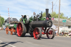 Before the parade even started this wood burning steam engine slowly made it's way along the route
