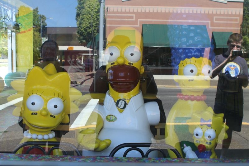 The Simpsons in the yogurt shop look kind of creepy if you aren't prepared to see them staring out of the window.