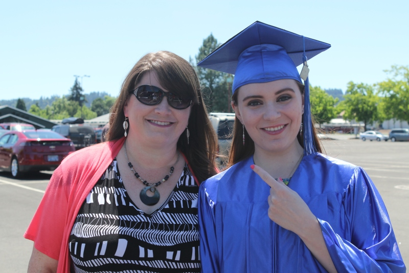 The graduate with her mama/teacher