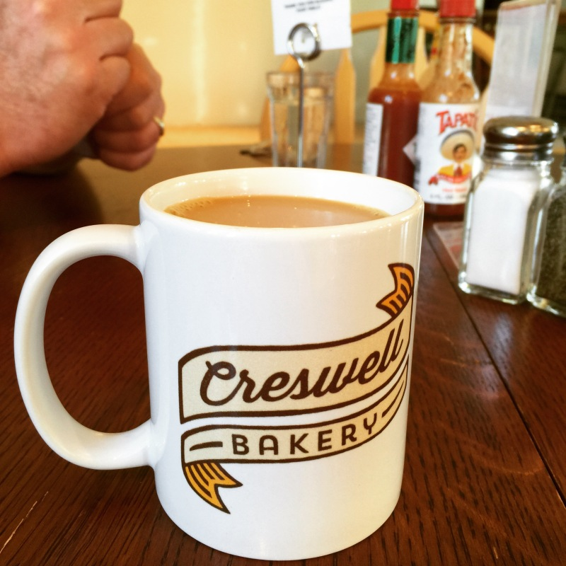 These coffee cups can be purchased for $10 at the Bakery